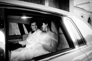 black-and-white-photo-of-newlyweds-in-limo