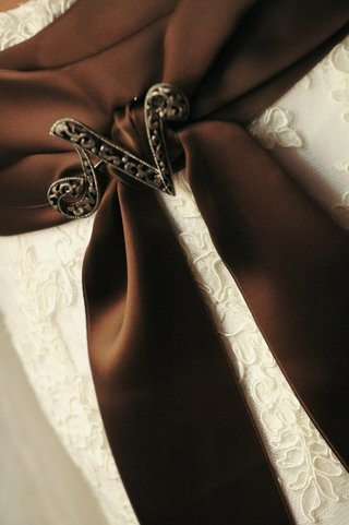 brown-wedding-dress-sash-with-n-shaped-brooch
