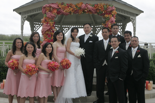 bride-in-a-vera-wang-gown-with-groom-and-groomsmen-in-black-tuxedos-and-bridesmaids-in-pink-dresses