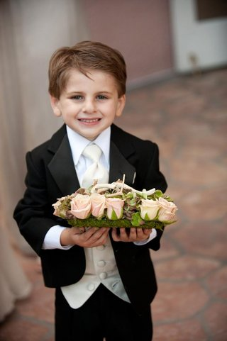cute-ring-bearer-tuxedo-and-bed-of-succulents