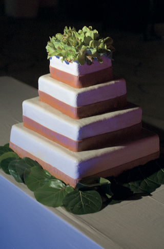 green-cymbidium-orchids-on-top-of-four-layer-cake