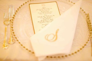 gold-bead-charger-plate-with-gold-menu-and-monogram-napkin