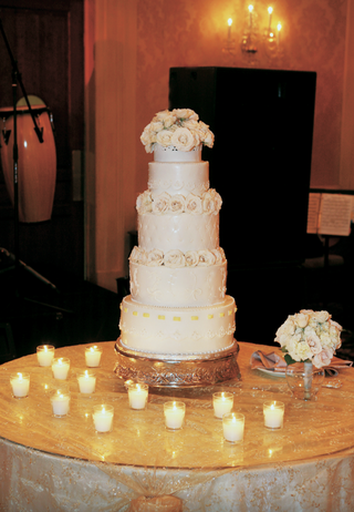 small-ivory-wedding-confection-with-candles