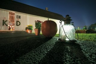 pumpkin-and-lantern-lead-way-to-barn-wedding-reception