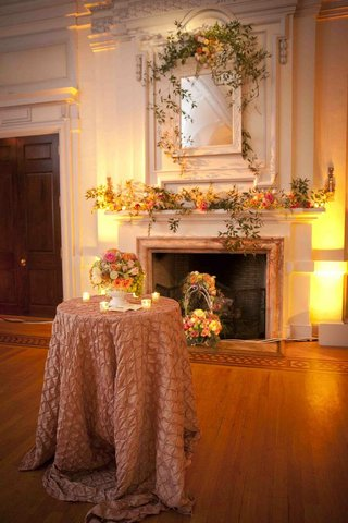 ivy-and-spring-inspired-flowers-on-fireplace-mantle