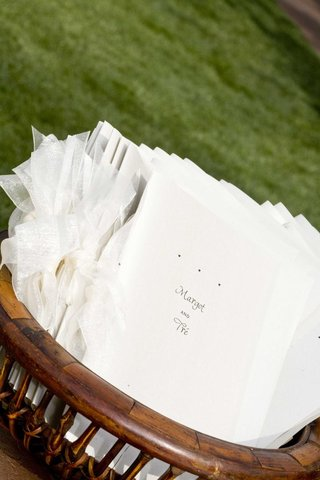 minimalist-wedding-programs-in-wooden-basket