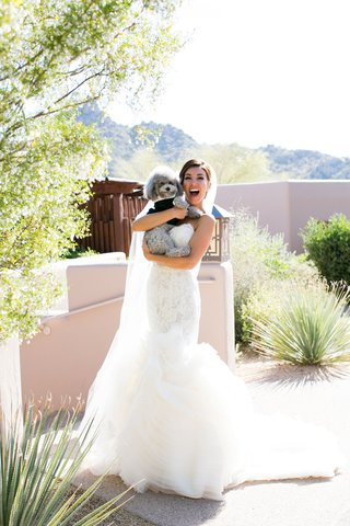 adrianna-costa-in-bridal-gown-holding-grey-poodle