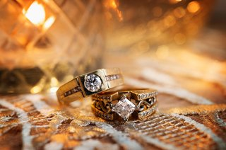 unique wedding ring yellow gold square base channel set diamonds scroll motif antique inspired