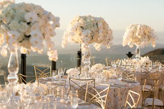 wedding reception at malibu rocky oaks vineyard estate white flowers gold chairs orchid rose classic