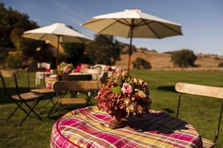 outdoor-ranch-cocktail-hour-with-pink-plaid-table-covers