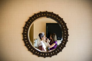 bride-and-makeup-artist-in-mirror
