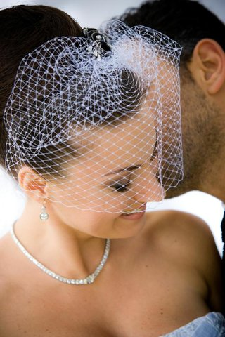 bride-wearing-short-white-french-net-veil
