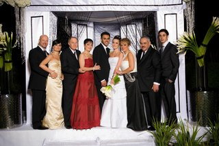 bride-and-groom-with-family-in-front-of-chuppah