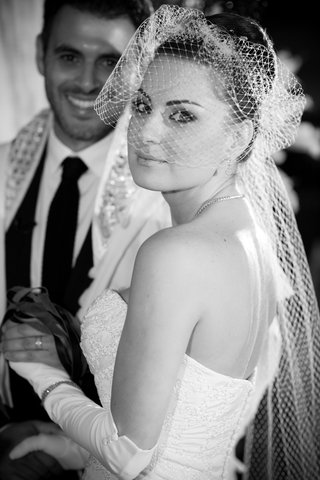 black-and-white-photo-of-bride-with-netted-veil
