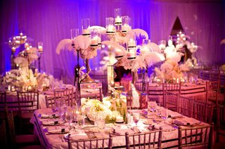 mirror-centerpiece-with-candles-feathers-and-flowers