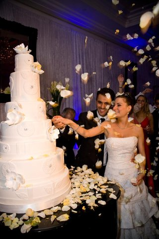 bride-and-groom-cut-white-wedding-cake
