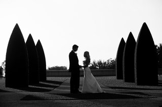 black-and-white-photo-of-newlyweds-on-lawn