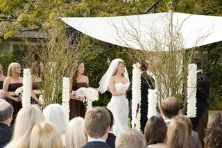 bride-and-bridesmaids-at-alfresco-wedding-ceremony