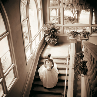 sepia-tone-picture-of-bride-walking-down-stairs