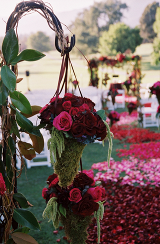 pink-and-red-flowers-hanging-from-iron-hook