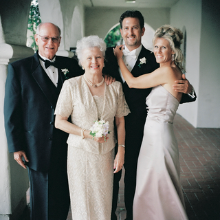 fancy-guests-in-tuxedos-and-formal-gown-and-mother-of-the-bride-dress