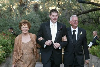 groom-and-parents-walking-down-aisle