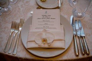 ritz-carlton-menu-card-and-white-orchid-on-napkin