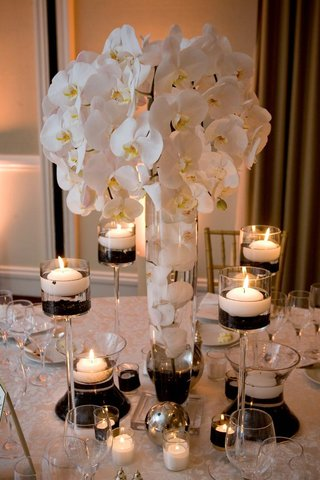 floating-candles-and-submerged-orchids-in-vases
