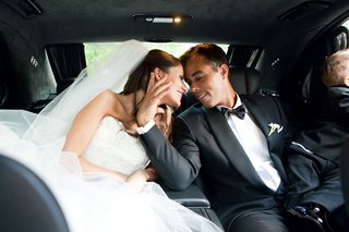 newlyweds-with-son-kiss-in-car