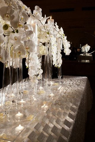 elegant-seating-card-table-with-white-orchids