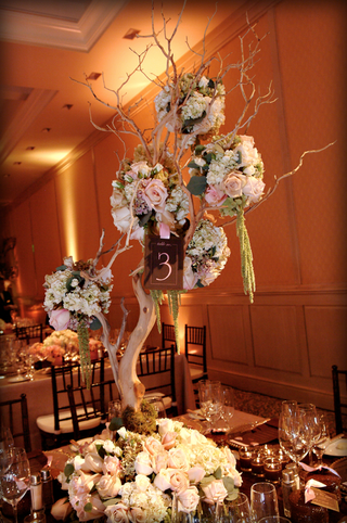 floral-embellished-tree-branches-on-table