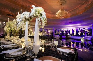 purple-lighting-on-dance-floor-and-tall-centerpieces