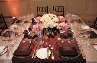 chocolate-colored-tablecloths-and-pink-rose-centerpieces