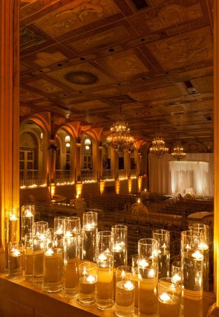 hurricane-vases-with-floating-candles-for-ballroom-ceremony