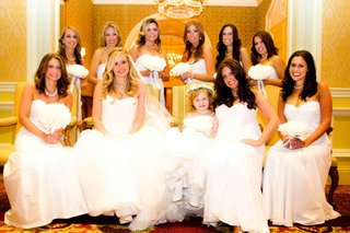 bride-with-flower-girl-and-bridesmaids-in-white-gowns