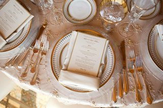 beaded-linens-topped-with-gold-rimmed-plates