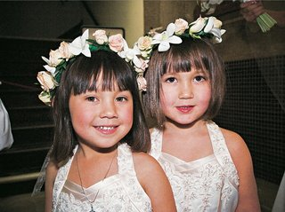 flower-girls-wearing-halter-dresses-and-floral-crowns