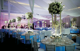 white-drapes-and-tall-centerpiece-designs