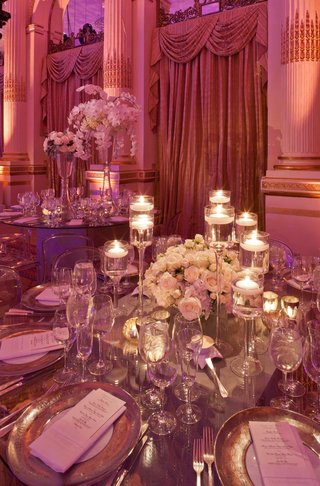 tall-glass-candleholders-with-white-rose-centerpiece