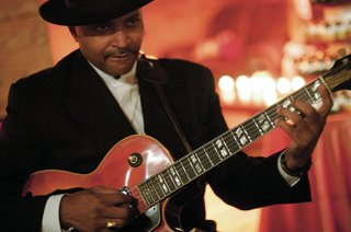 african-american-man-playing-guitar-in-black-hat