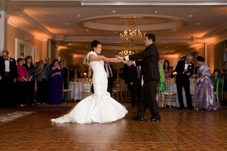 bride-and-groom-on-ballroom-wood-dance-floor