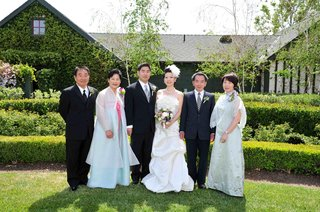asian-wedding-family-guests-in-front-of-home