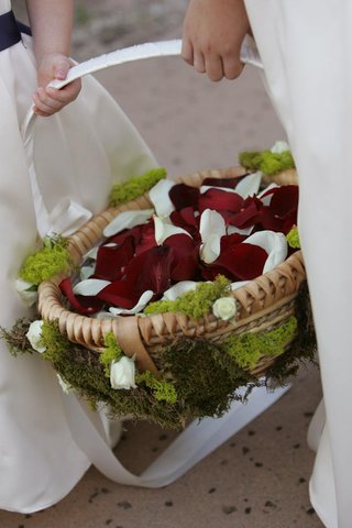 moss-covered-tan-basket-filled-with-petals