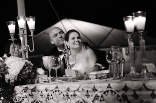 black-and-white-photo-of-bride-and-groom-at-reception