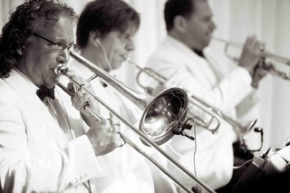 black-and-white-photo-of-live-band-musicians-at-a-wedding