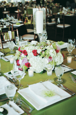 square-table-with-white-plates-and-green-tablecloth