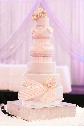 white-wedding-cake-with-monogram-drapery-details-sugar-flowers-and-crystals