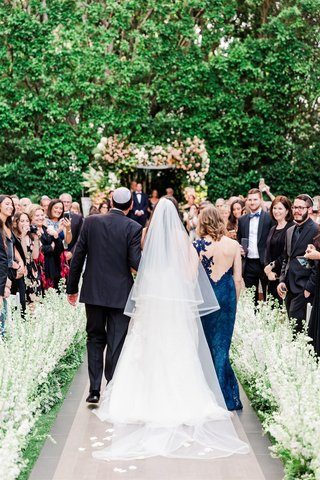 outdoor garden wedding at the four seasons los angeles at beverly hills bride with parents walking