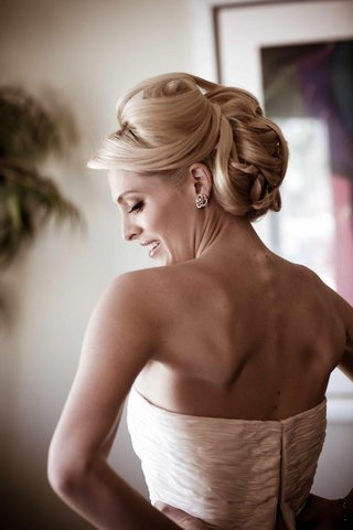 bride-getting-dress-zipped-with-hair-and-makeup-done