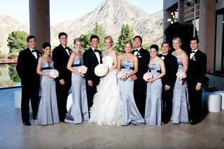 blue-bridesmaids-and-groomsmen-in-tuxedos